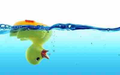 Rubber Duck upside down in water losing bubbles