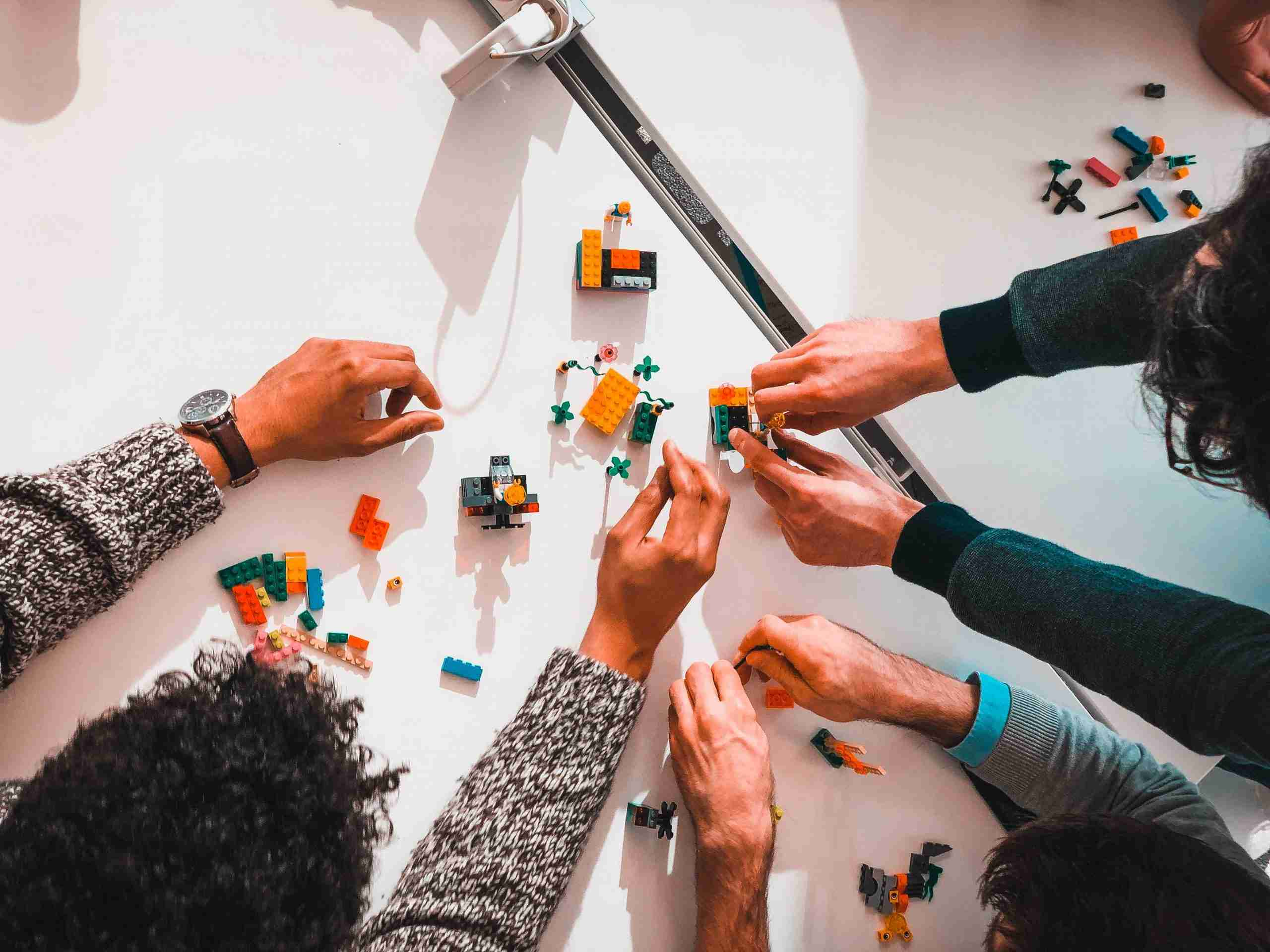 An image of a team working together to build using lego